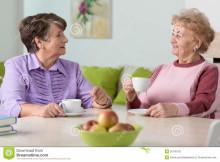 http://www.dreamstime.com/royalty-free-stock-photo-elderly-women-drinking-coffee-sitting-table-image50100155